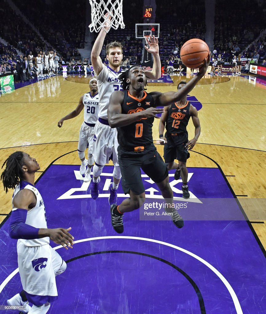 Brandon Averette #0 of the Oklahoma State Cowboys drives to the basket and scores against the Kansas State Wildcats during the first half on January 10, 2018 at Bramlage Coliseum in Manhattan, Kansas.