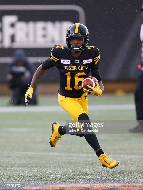 Brandon Banks of the Hamilton TigerCats carries the ball against the Saskatchewan Roughriders during a game at Tim Hortons Field on June 13 2019...