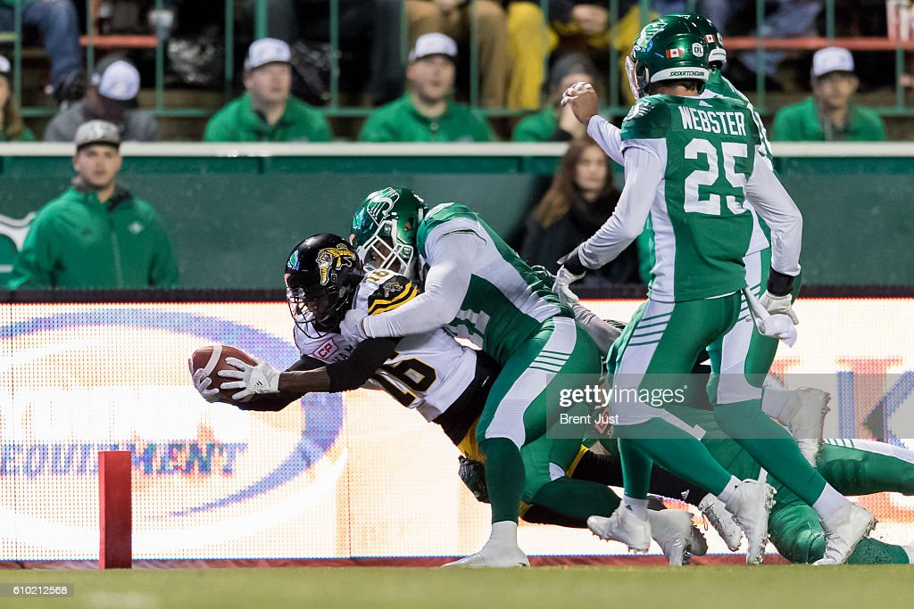 Brandon Banks #16 of the Hamilton Tiger-Cats falls across the goal line for a touchdown in first half action in the game between the Hamilton Tiger-Cats and Saskatchewan Roughriders at Mosaic Stadium on September 24, 2016 in Regina, Canada.