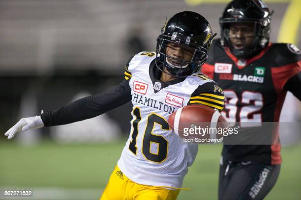 Brandon Banks of the Hamilton TigerCats holds the ball out to get a first down against the Ottawa Redblacks in Canadian Football League play at TD...