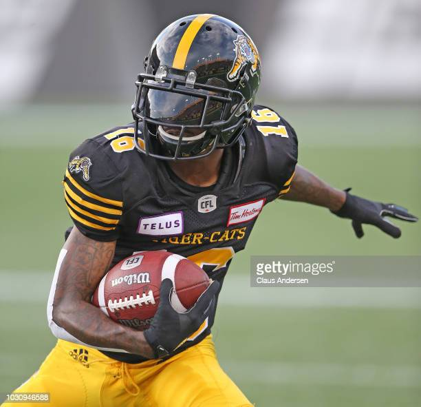 Brandon Banks of the Hamilton Tiger-cats runs with a reception against the Toronto Argonauts in a CFL game at Tim Hortons Field on September 3, 2018...
