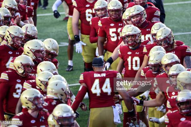 Brandon Barlow of the Boston College Eagles runs through a tunnel of teammates to celebrate senior night before the game against the Louisville...