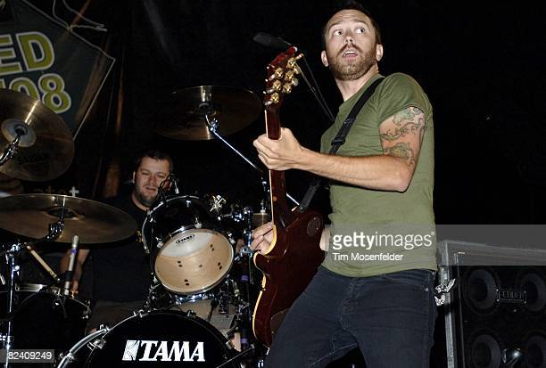 a809618ce0d086 Brandon Barnes and Tim McIlrath of Rise Against perform as part of the Vans  Warped Tour