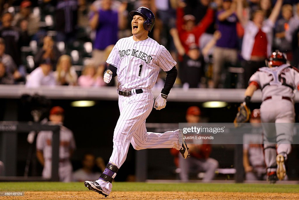 Brandon Barnes #1 of the Colorado Rockies celebrates after hitting an inside-the-park home run during the eighth inning against the Arizona Diamondbacks at Coors Field on June 5, 2014 in Denver, Colorado.