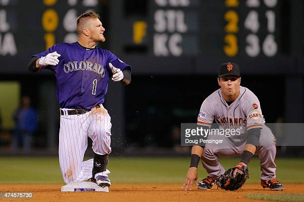 Brandon Barnes of the Colorado Rockies celebrates after sliding safely in to second with an RBI double against second baseman Joe Panik of the San...