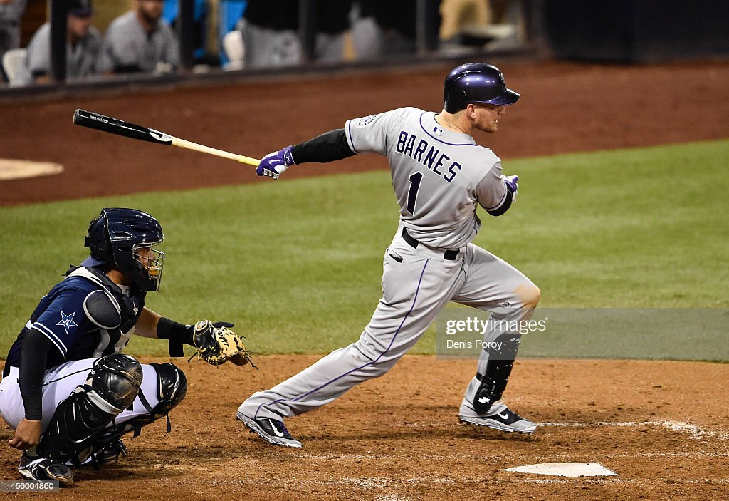 Brandon Barnes #1 of the Colorado Rockies hits a single during the ninth inning of a baseball game against the San Diego Padres at Petco Park September, 23, 2014 in San Diego, California.