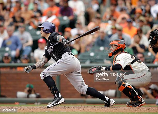 Brandon Barnes of the Colorado Rockies hits an insidethepark home run in the ninth inning of their game against the San Francisco Giants at ATT Park...