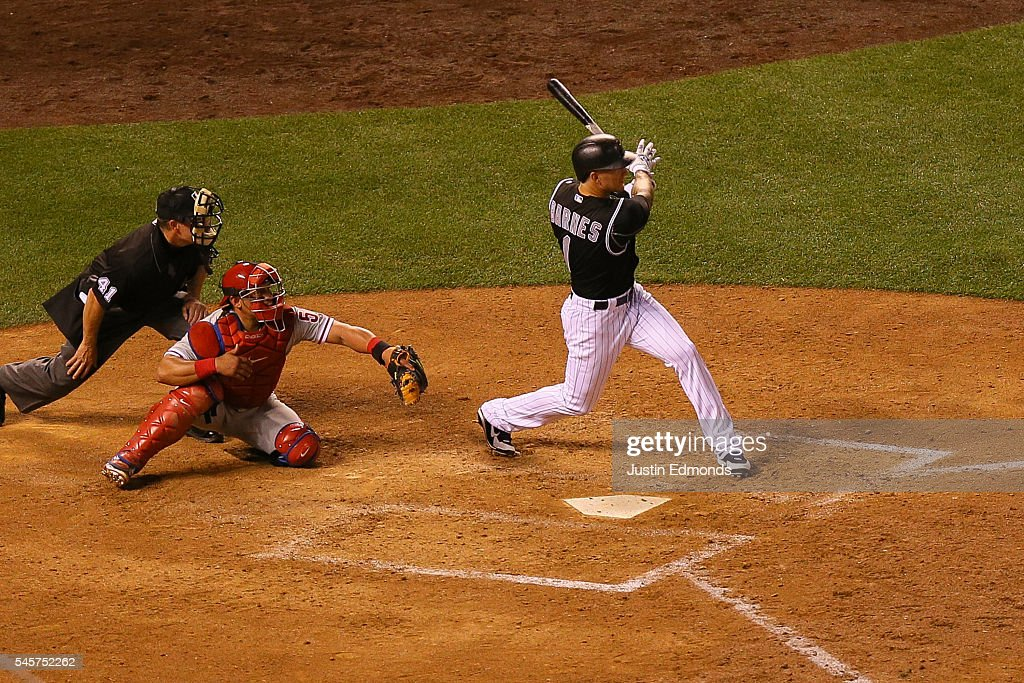 Brandon Barnes #1 of the Colorado Rockies watches his RBI double during the sixth inning against the Philadelphia Phillies at Coors Field on July 9, 2016 in Denver, Colorado.