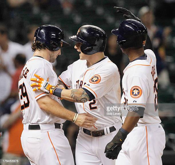 Brandon Barnes of the Houston Astros celebrates with LJ Hoes and Brett Wallace after hitting a threerun home run in the ninth inning to tie the game...