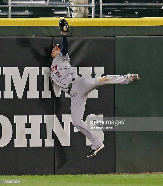 Brandon Barnes of the Houston Astros robs Adam Dunn of the Chicago White Sox of a hit in the 4th inning at US Cellular Field on August 26 2013 in...
