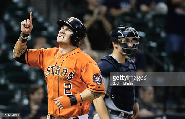 Brandon Barnes of the Houston Astros scores a run in the eighth inning against the Seattle Mariners at Minute Maid Park on July19 2013 in Houston...