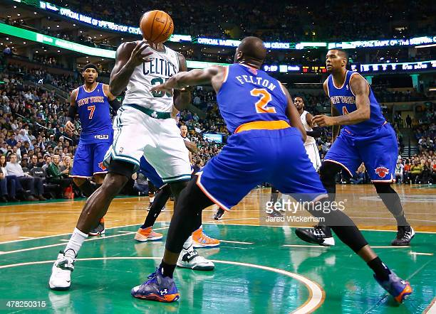 Brandon Bass of the Boston Celtics attempts to grab a rebound in front of Raymond Felton of the New York Knicks in the second half during the game at...
