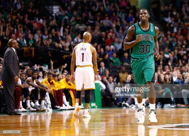 Brandon Bass of the Boston Celtics celebrates after making a threepoint shot in the fourth quarter against the Cleveland Cavaliers during the game at...