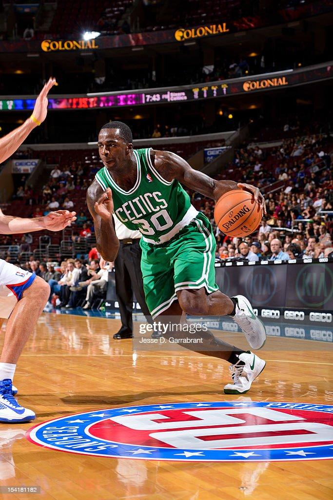 Brandon Bass #30 of the Boston Celtics drives against the Philadelphia 76ers during a pre-season game at the Wells Fargo Center on October 15, 2012 in Philadelphia, Pennsylvania.