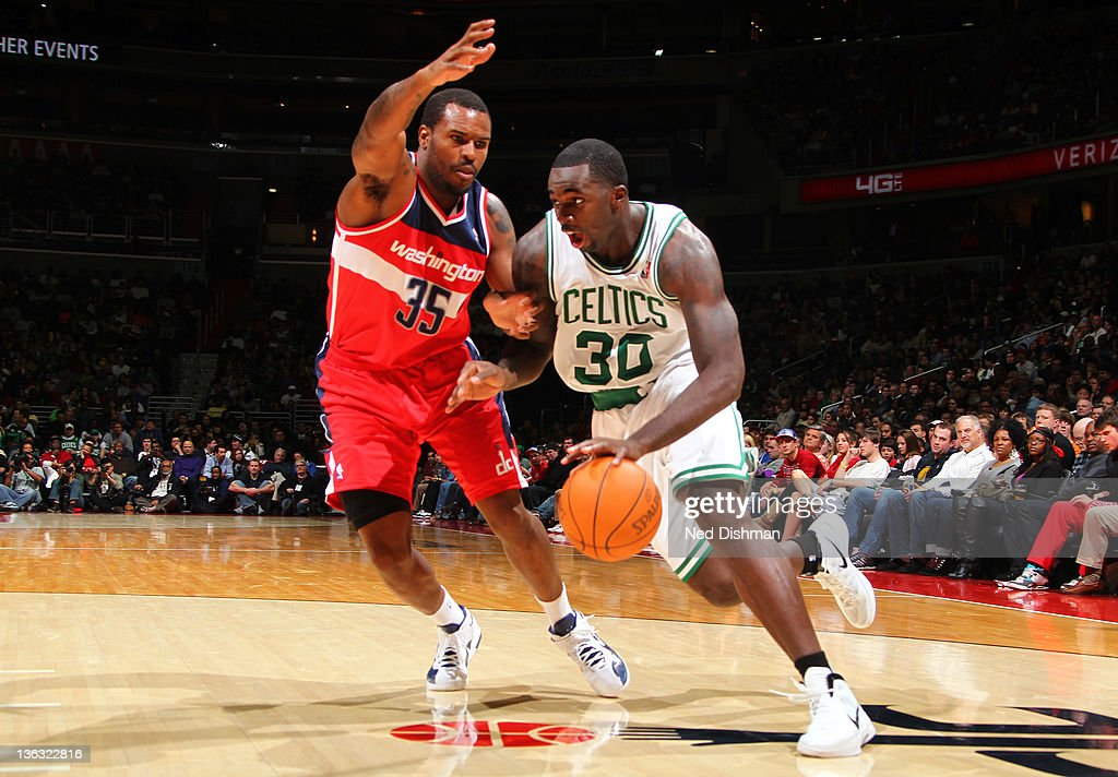Brandon Bass #30 of the Boston Celtics drives against Trevor Booker #35 of the Washington Wizards during the game at the Verizon Center on January 1, 2012 in Washington, DC.