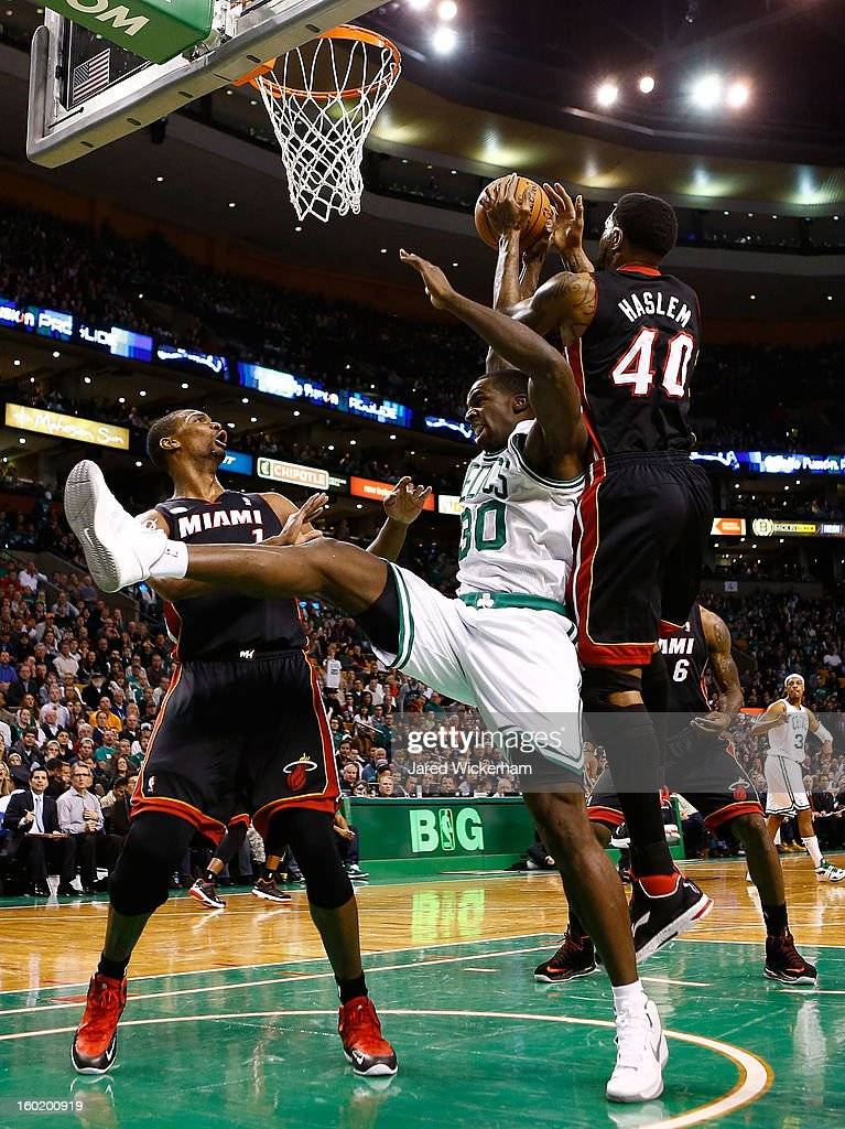 Brandon Bass #30 of the Boston Celtics fights for a loose ball against Udonis Haslem #40 of the Miami Heat during the game on January 27, 2013 at TD Garden in Boston, Massachusetts.