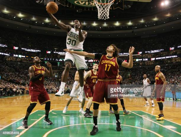 Brandon Bass of the Boston Celtics goes up for a layup in front of Anderson Verejao of the Cleveland Cavaliers in the second half during the game at...