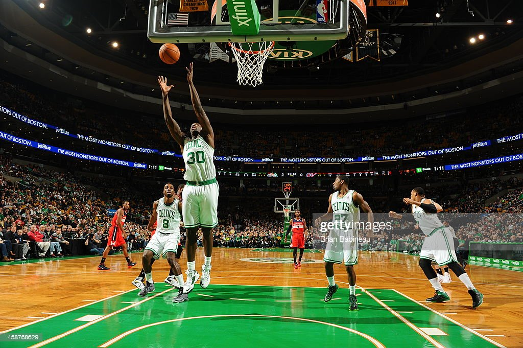 Brandon Bass #30 of the Boston Celtics grabs a rebound against the Washington Wizards on December 21, 2013 at the TD Garden in Boston, Massachusetts.