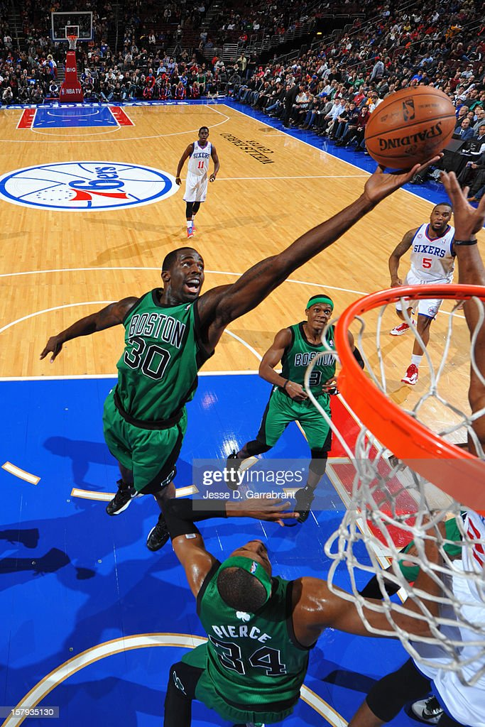 Brandon Bass #30 of the Boston Celtics grabs the rebound against the Philadelphia 76ers at the Wells Fargo Center on December 7, 2012 in Philadelphia, Pennsylvania.