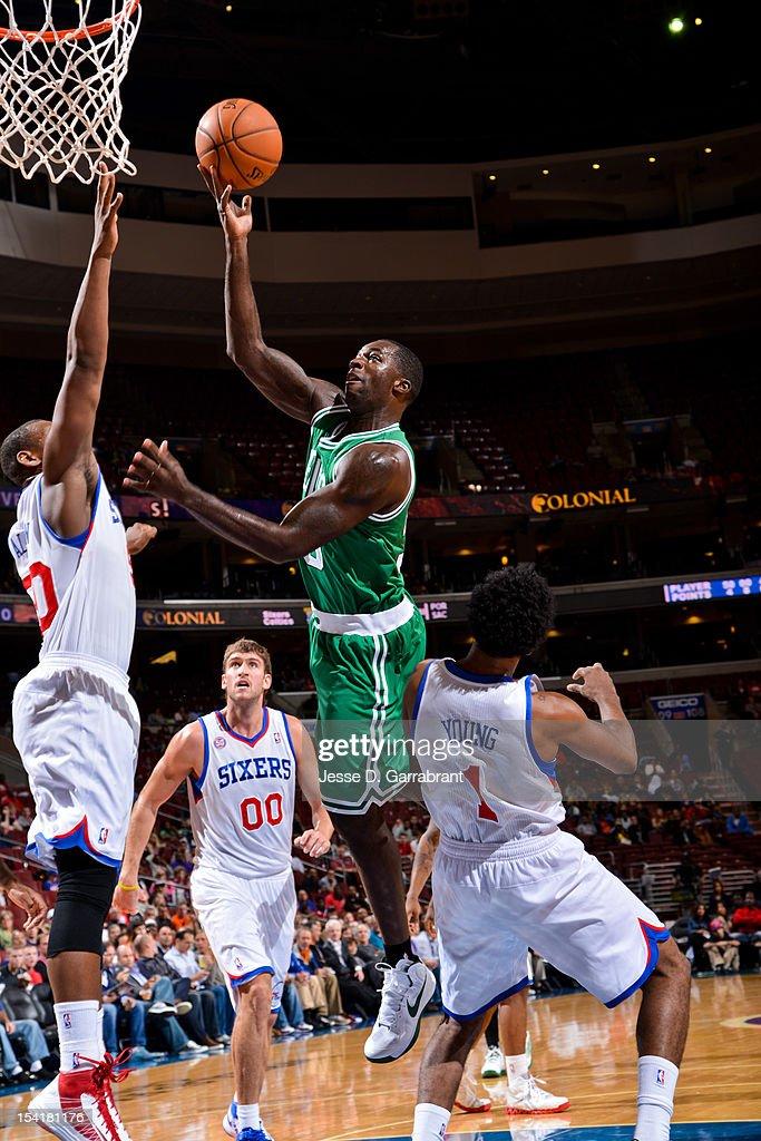 Brandon Bass #30 of the Boston Celtics shoots against Lavoy Allen #50 of the Philadelphia 76ers during a pre-season game at the Wells Fargo Center on October 15, 2012 in Philadelphia, Pennsylvania.