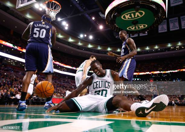 Brandon Bass of the Boston Celtics sits on the court after falling awkwardly for a rebound against the Memphis Grizzlies during the game at TD Garden...