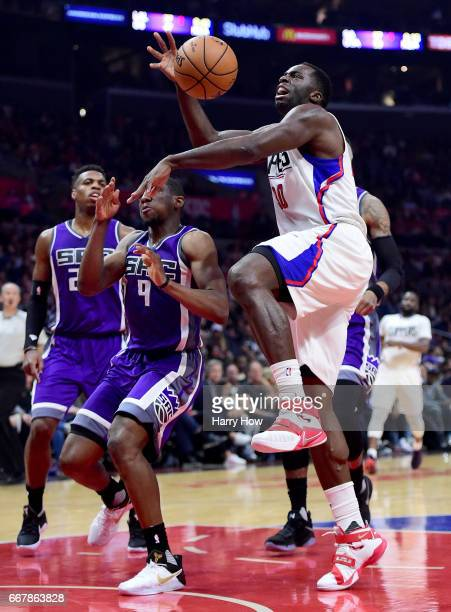 Brandon Bass of the LA Clippers is fouled by Langston Galloway of the Sacramento Kings as he drives to the basket during the first half at Staples...