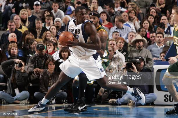 Brandon Bass of the Dallas Mavericks moves the ball during the NBA game against the Seattle SuperSonics at American Airlines Center on January 19...