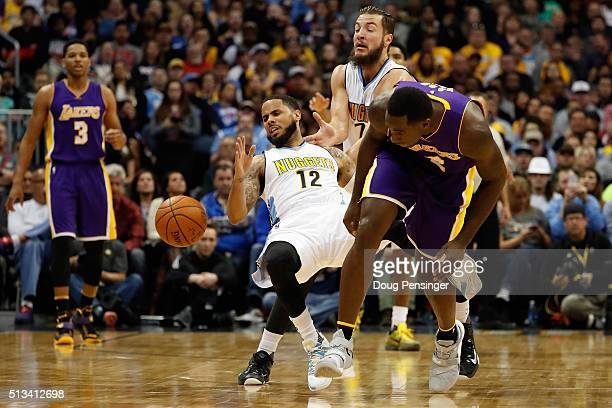 Brandon Bass of the Los Angeles Lakers is called for a foul as he collides with DJ Augustin of the Denver Nuggets as they chase a loose ball at Pepsi...
