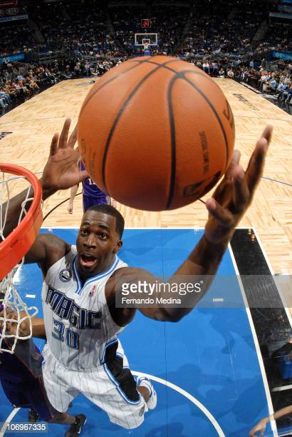 Brandon Bass of the Orlando Magic grabs a rebound against the Phoenix Suns on November 18 2010 at the Amway Center in Orlando Florida NOTE TO USER...