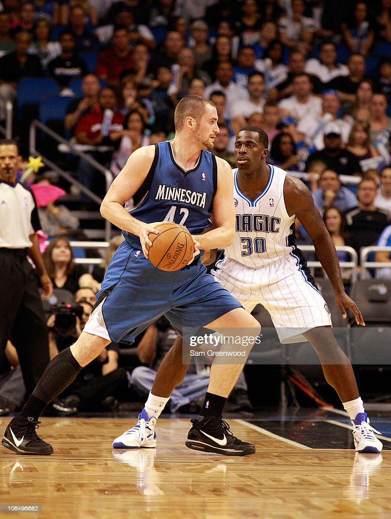 Brandon Bass #30 of the Orlando Magic guards Kevin Love #42 of the Minnesota Timberwolves during the game at Amway Arena on November 3, 2010 in Orlando, Florida.