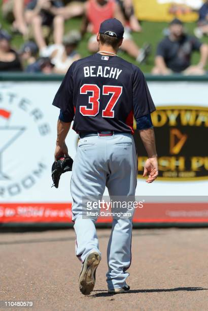 Brandon Beachy of the Atlanta Braves walks off the field against the Detroit Tigers during the spring training game at Joker Marchant Stadium on...