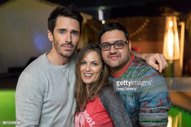 Brandon Beemer Terri Ivens and Gregori J Martin attend The Bay Ugly Sweater And Secret Santa Christmas Party at Private Residence on December 12 2017...