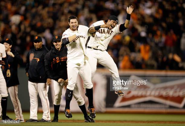 Brandon Belt of the San Francisco Giants and Hector Sanchez of the San Francisco Giants celebratre after Belt hit a walkoff single that scored Andres...