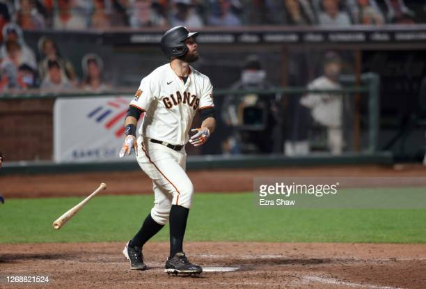 Brandon Belt of the San Francisco Giants hits a home run in the ninth inning to tie their game against the Los Angeles Dodgers at Oracle Park on...