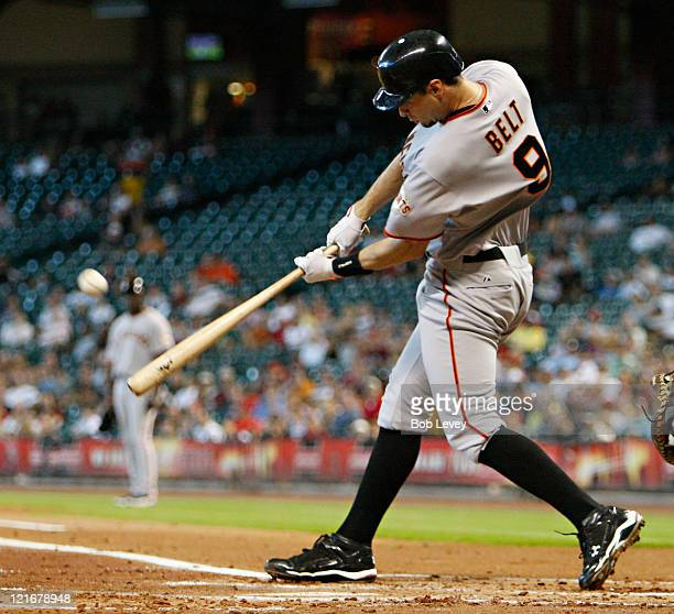 Brandon Belt of the San Francisco Giants hits a three run home run to right field in the first inning against the Houston Astros at Minute Maid Park...