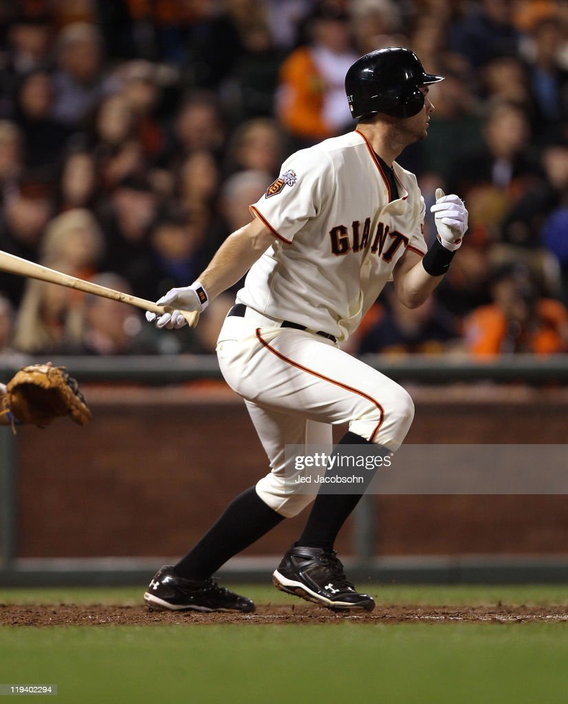 Brandon Belt #9 of the San Francisco Giants hits a two-run double in the seventh inning against the Los Angeles Dodgers at AT&T Park on July 19, 2011 in San Francisco, California.