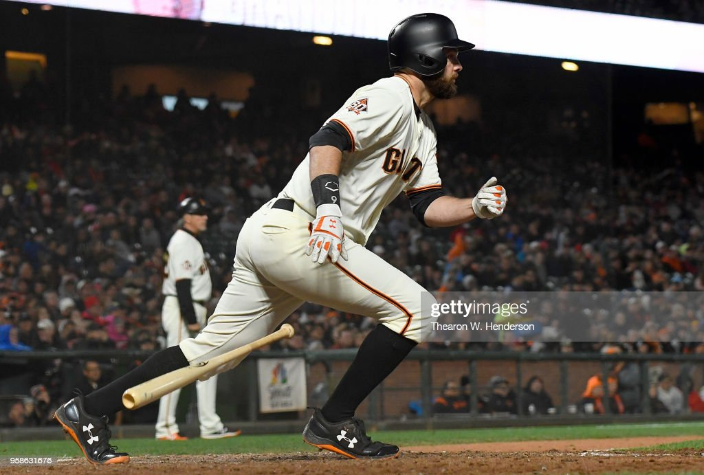 Brandon Belt #9 of the San Francisco Giants hits a two-run rbi double against the Cincinnati Reds in the bottom of the six inning at AT&T Park on May 14, 2018 in San Francisco, California.