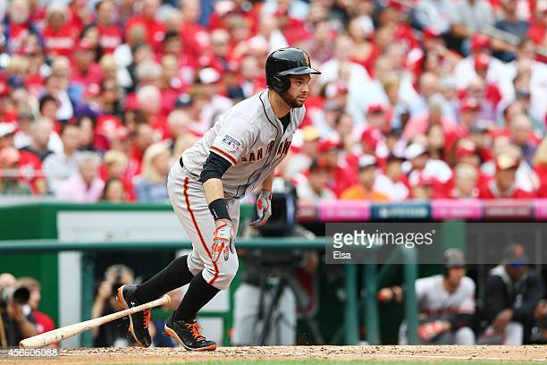 Brandon Belt of the San Francisco Giants hits an RBI single scoring Hunter Pence in the fourth inning during Game One of the National League Division...