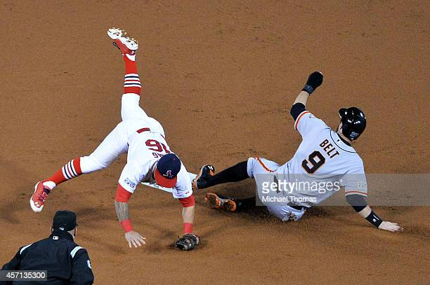 Brandon Belt of the San Francisco Giants is out at second by Kolten Wong of the St. Louis Cardinals on a fielder's choice hit by Brandon Crawford of...