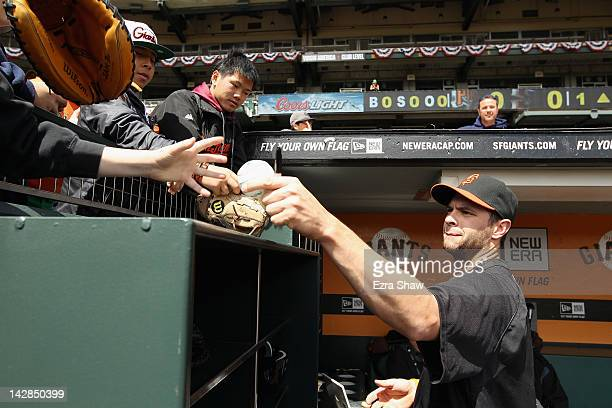 Brandon Belt of the San Francisco Giants signs autographs before their game against the Pittsburgh Pirates at ATT Park on April 13 2012 in San...