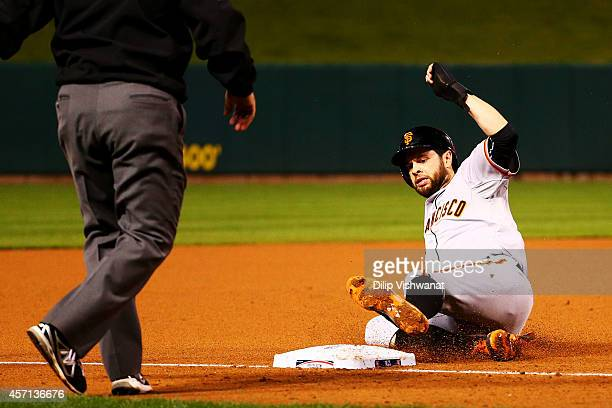 Brandon Belt of the San Francisco Giants slides into third in the fifth inning against the St Louis Cardinals during Game Two of the National League...