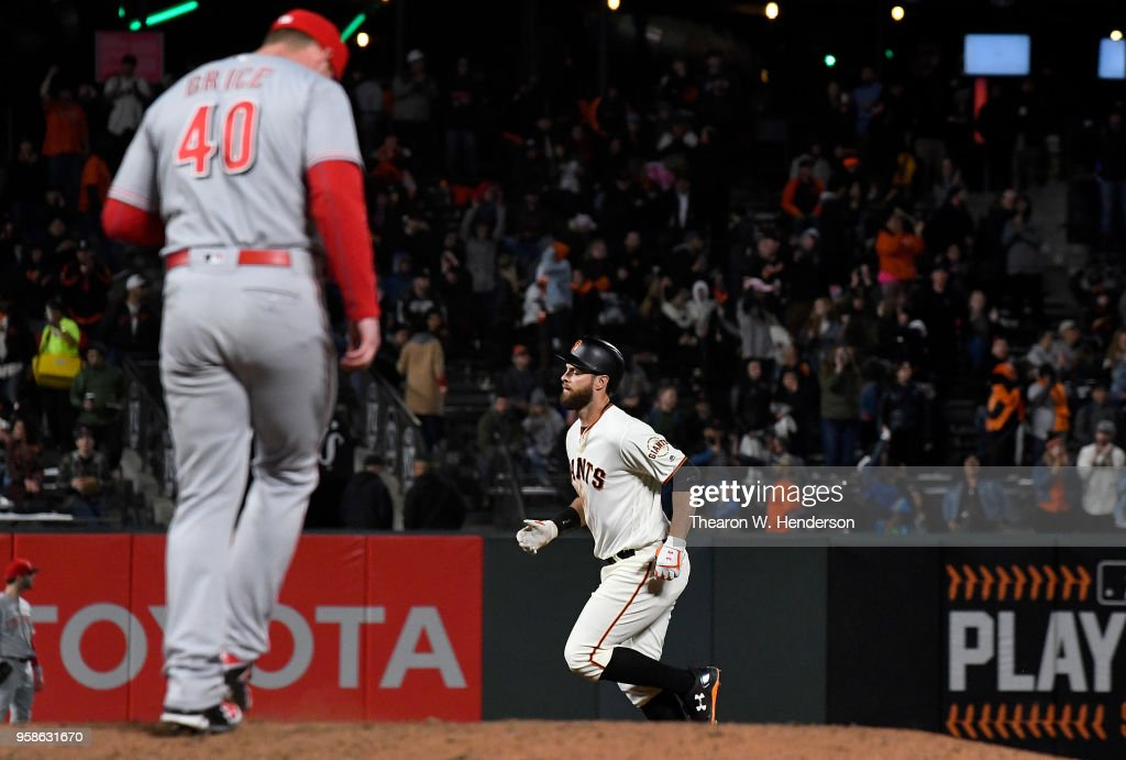 Brandon Belt #9 of the San Francisco Giants trots around the bases after hitting a solo home run off of Austin Brice #40 of the Cincinnati Reds in the bottom of the eighth inning at AT&T Park on May 14, 2018 in San Francisco, California. The Giants won the game 10-7.