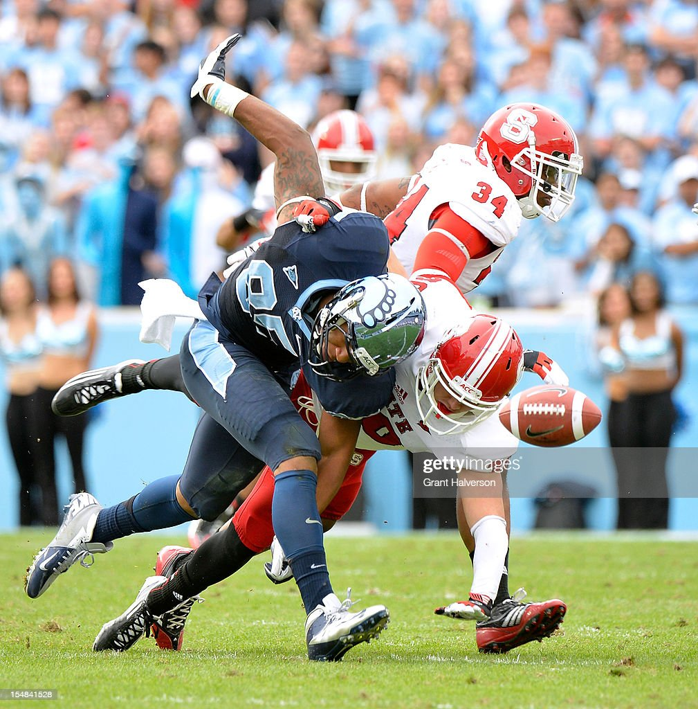 Brandon Bishop #30 of the North Carolina State Wolfpack breaks up a pass intended for Eric Ebron #85 of the North Carolina Tar Heels during play at Kenan Stadium on October 27, 2012 in Chapel Hill, North Carolina. North Carolina won 43-35.