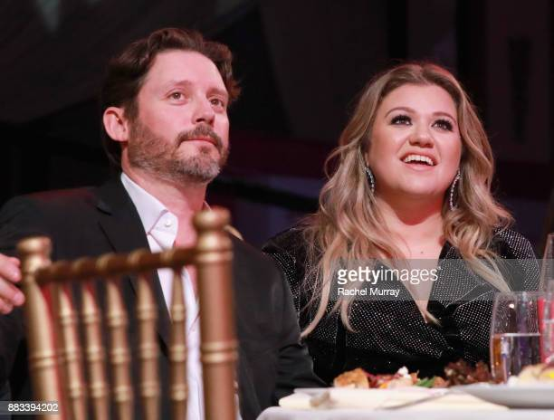 Brandon Blackstock and honoree Kelly Clarkson attend Billboard's Women in Music 2017 presented in partnership with FIJI Water on November 30 2017 in...