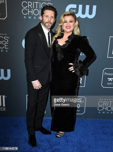 Brandon Blackstock and Kelly Clarkson arrives at the 25th Annual Critics' Choice Awards at Barker Hangar on January 12 2020 in Santa Monica California