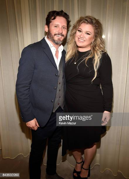 Brandon Blackstock and Kelly Clarkson backstage after she performed songs from her new album The Meaning of Life at The Rainbow Room on September 6...
