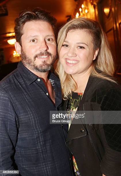 Brandon Blackstock and wife Kelly Clarkson pose backstage at the hit musical Finding Neverland on Broadway at The Lunt Fontanne Theater on July 15...