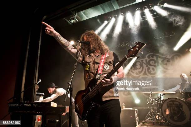 Brandon Bliss Jon Harvey and Steve Kiely of the Canadian band Monster Truck perform live during a concert at the Columbia Theater on April 1 2017 in...