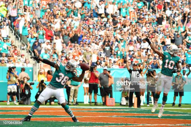 Brandon Bolden of the Miami Dolphins celebrates after scoring a touchdwon during the second quarter against the New England Patriots at Hard Rock...