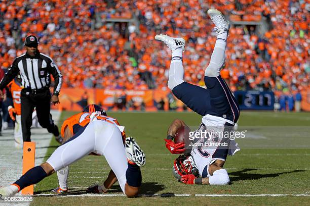 Brandon Bolden of the New England Patriots is tackled by TJ Ward of the Denver Broncos after a 20yard run in the first half in the AFC Championship...